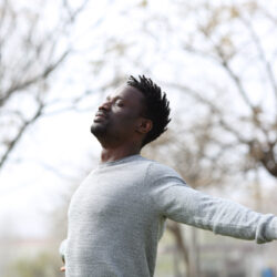 Black man inhaling fresh air, exercising to improve male fertility | Dallas IVF