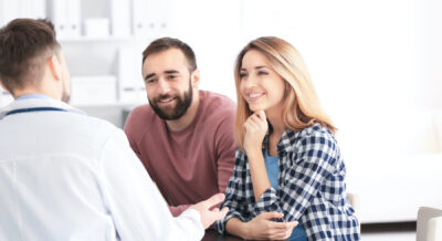 Couple consulting with fertility specialist discussing signs of infertility| Dallas IVF | Frisco, TX