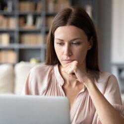 Woman looks at declining fertility report | Dallas IVF | Frisco & Dallas, TX