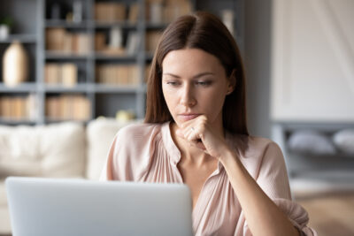 Woman looks at declining fertility report   Dallas IVF   Frisco & Dallas, TX